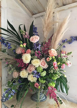 floral urn, wedding urn, roses and delphiniums