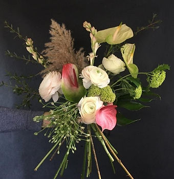 modern bouquet of rannunculas, celosia, anturium, tuberose spiral bouquet