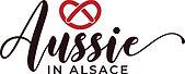 'Aussie in Alsace' logo with a red pretze above the word 'Aussie' in cursive script.