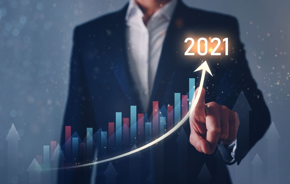 Person in a suit pointing to a virtual chart where the year 2021 stands out
