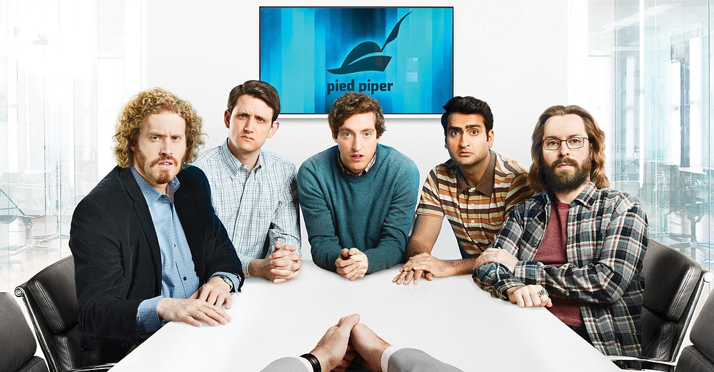 Main cast of the Silicon Valley series seated at a conference table