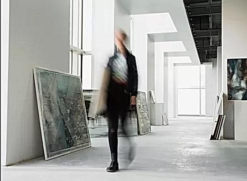 Girl walking through gallery