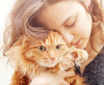 Happy pet owner with cat.jpg