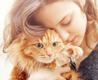 Woman hugging cat.jpg