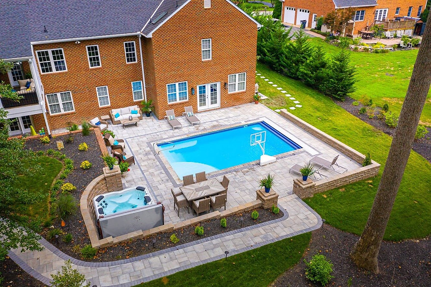 Paver patio around pool by New Leaf Landscaping Richmond VA