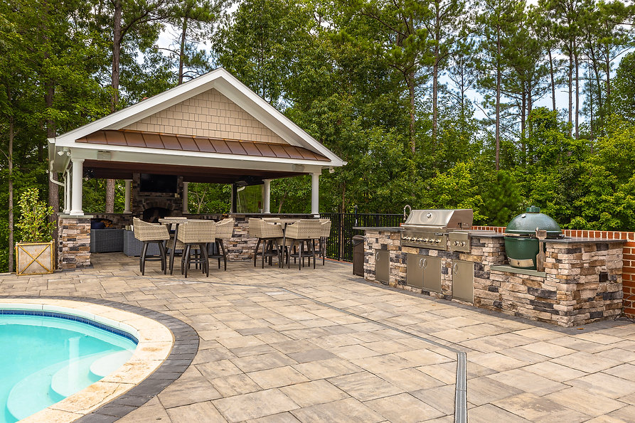 Paver patio and outdoor kitchen by New Leaf Landscaping Richmond VA