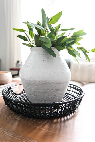 White vase with faux eucalyptus