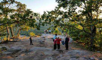 Hikers gather at the top of Hawk Mountain