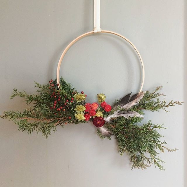 Winter wreath of evergreens and dried flowers