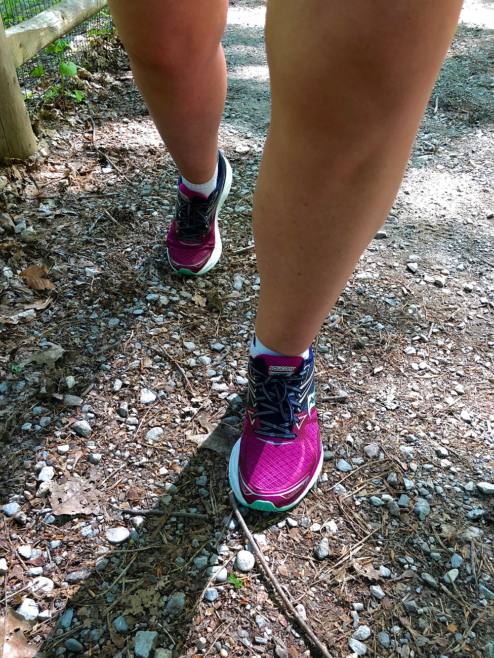 Photo of runners shoes on a gravel path