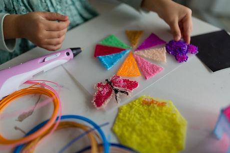 Cute little girl makes a plastic house,
