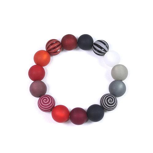 Armband Wasserballperle halb schwarz halb rot