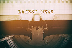 Old typewriter with text LATEST NEWS. Bu