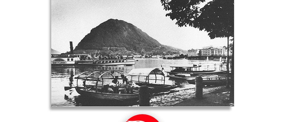 Lugano vista sul lago con pescatori e battello Gottardo