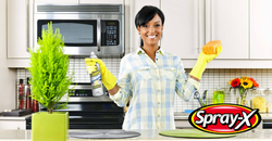 Woman In Kitchen Holding Spray-X with Lo