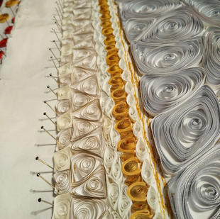 ....every coiled shape created individually and then pinned into place...