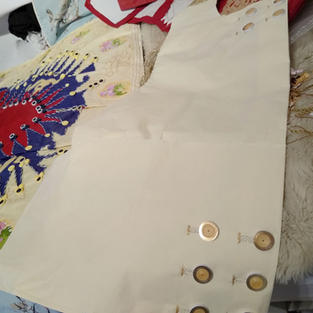 The buttons of the waistcoat were likewise formed as tight coils of quilling using gold edged white paper strips.