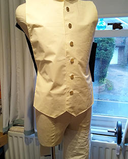 The buttons of the waistcoat and tight quilled circles.