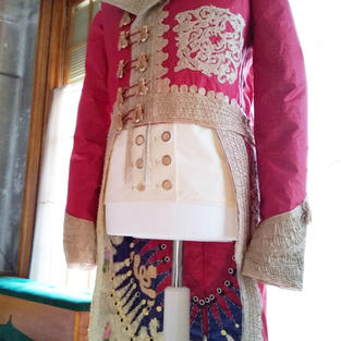 The shape of the embroidery on the chest of this piece is from the hood on the Burnous cloak.