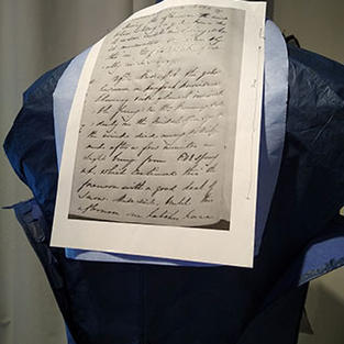 Once the body of the frockcoat was completed more of the text from Masie's diary was traced onto the back of the piece using blue transfer paper.