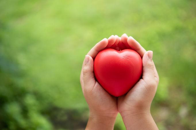 2-child-holding-red-rubber-heart.jpg