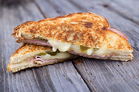 ham and cheese sandwich on rustic wooden