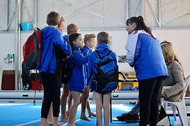 Coach preparing gymnast