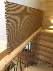 domy z bali - ozdobna ściana ze sznura