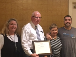 Marge Schwallie getting an award at an OAR meeting, presented by OAR Executive Director Michael Maloney  with Cathy  & Tom Schwallie