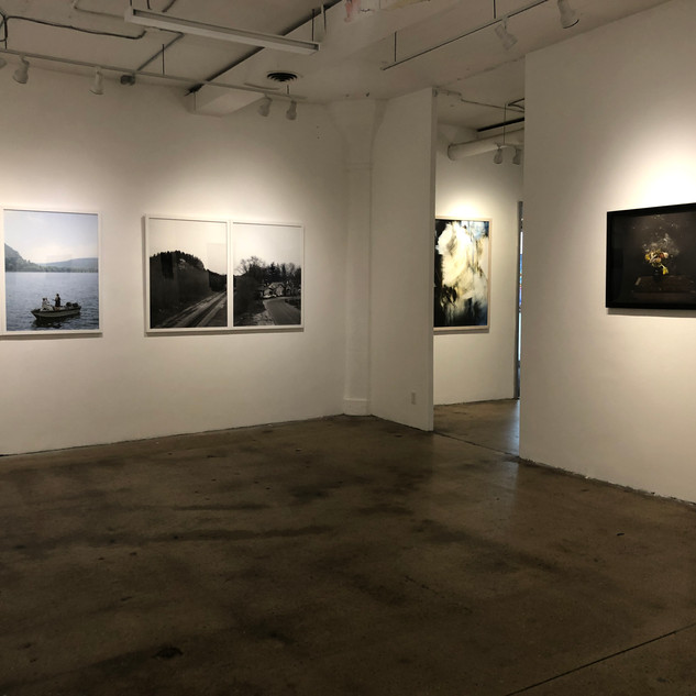 Installation view with work by Mark Brautigam and Lauren Semivan, What On Earth