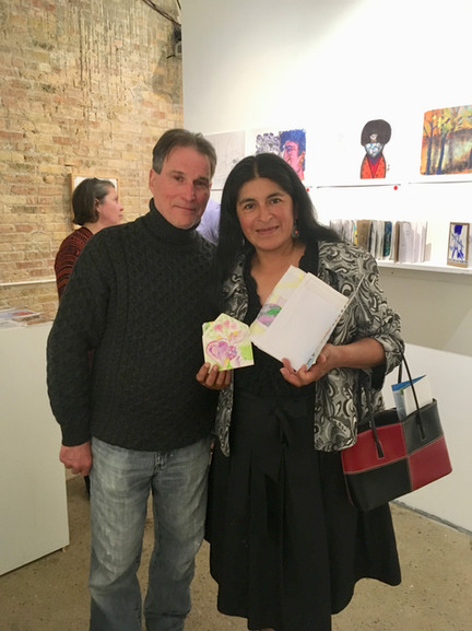 Julia Ramirez and the new owner of her sketchbook