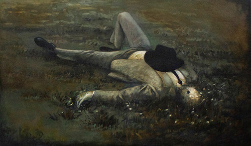 Man Lying in a Field
