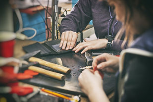 Two young womans work  with leather.jpg