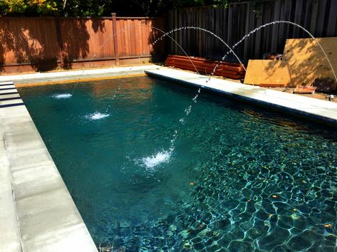 Custom pool with shooting water