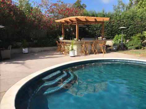 Custom pool and bbq island with arbor