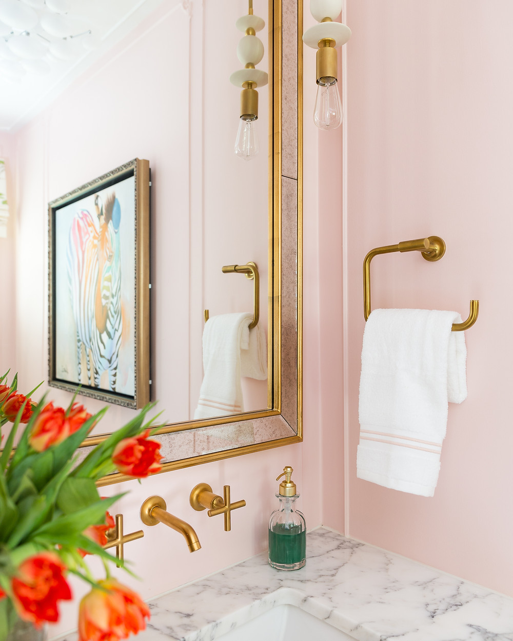 blush walls in powder room with orange tulips