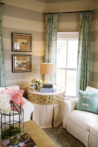 Modern farmhouse style living room with blue and white damask draperies