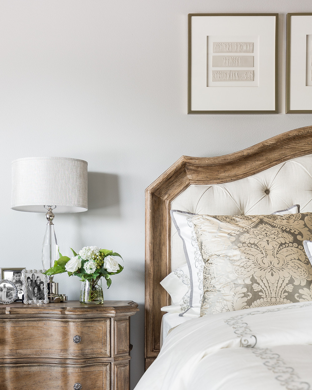 master bedroom with upholstered headboard and custom bedding