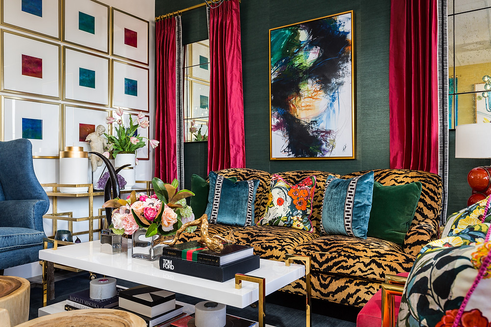 Maximalist living room with tiger stripe sofa and gallery wall with green grasscloth