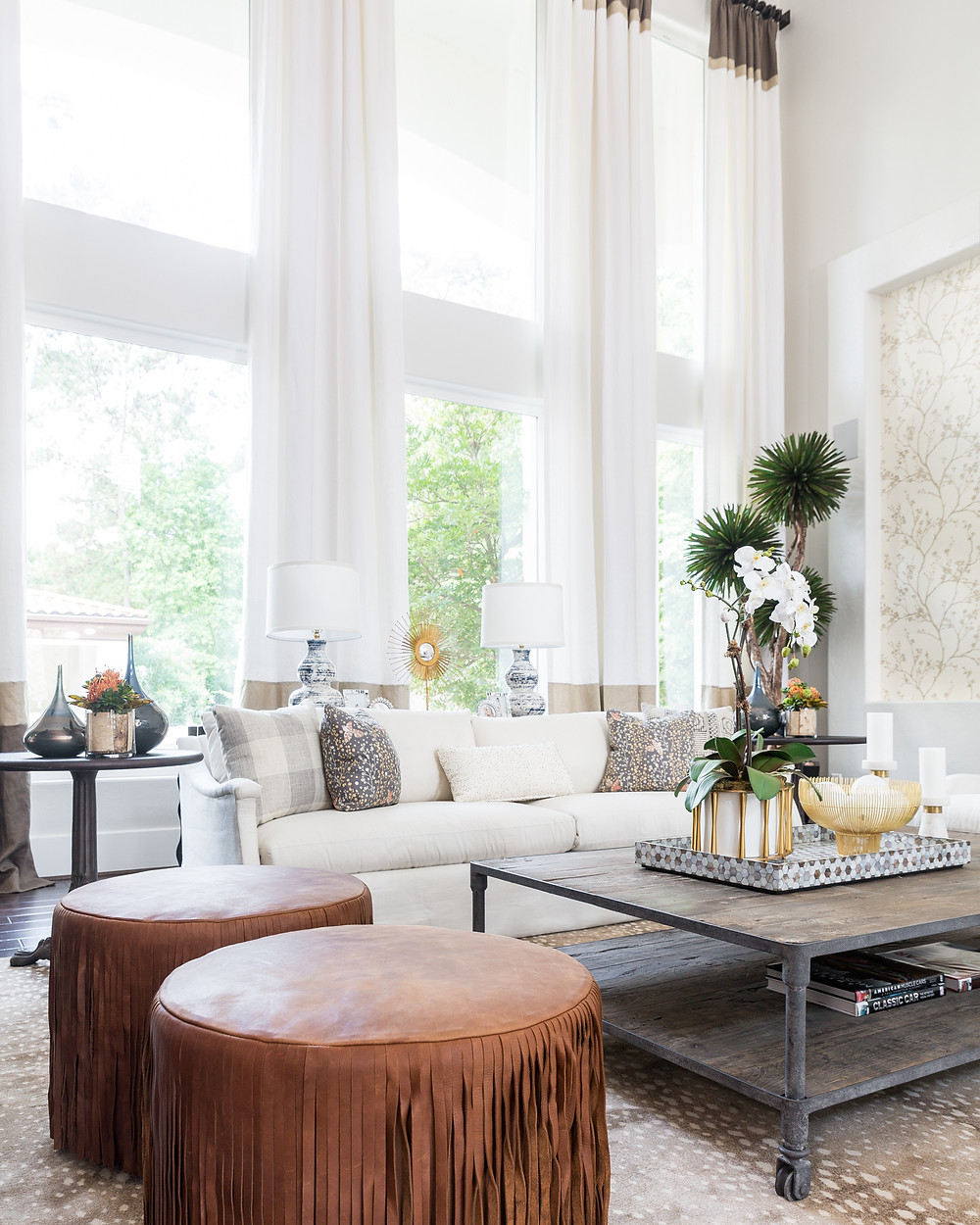 Living room vignette with white skirted sofa in linen fabric by Lee Industries