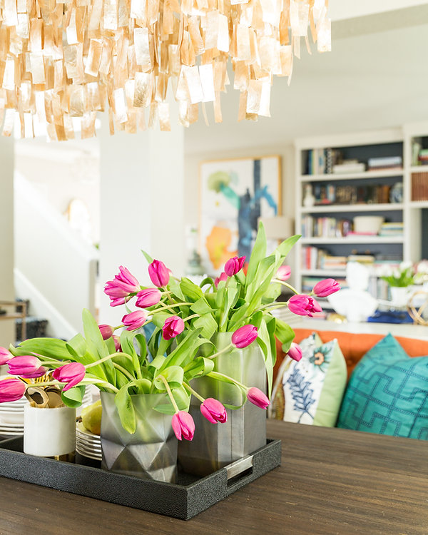 Dining room table with pink tulip flowers