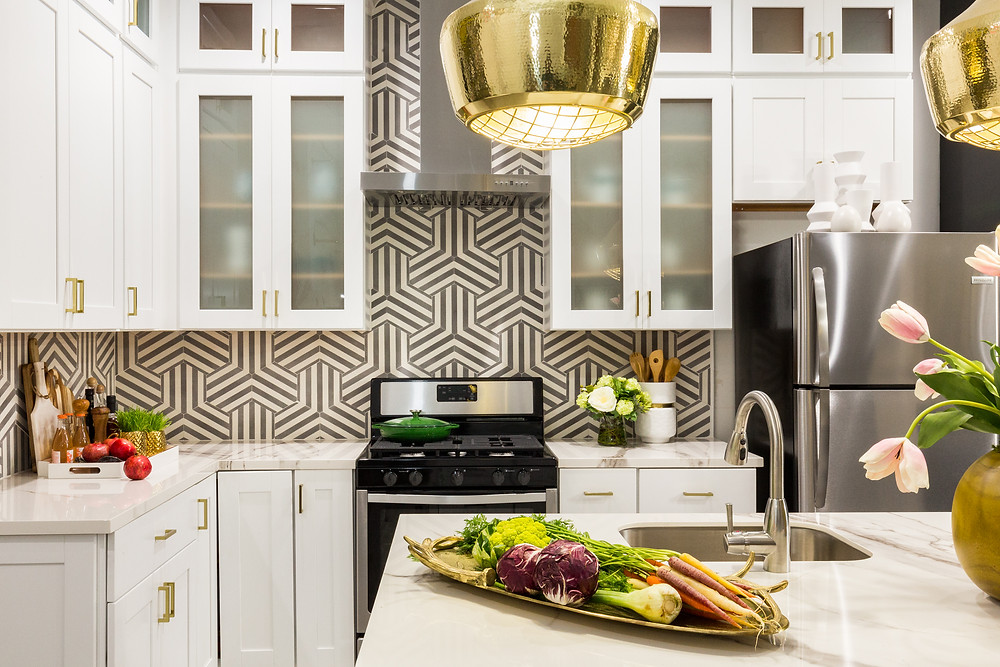 kitchen with graphic cement tile backsplash, porcelain countertops and white cabinetry