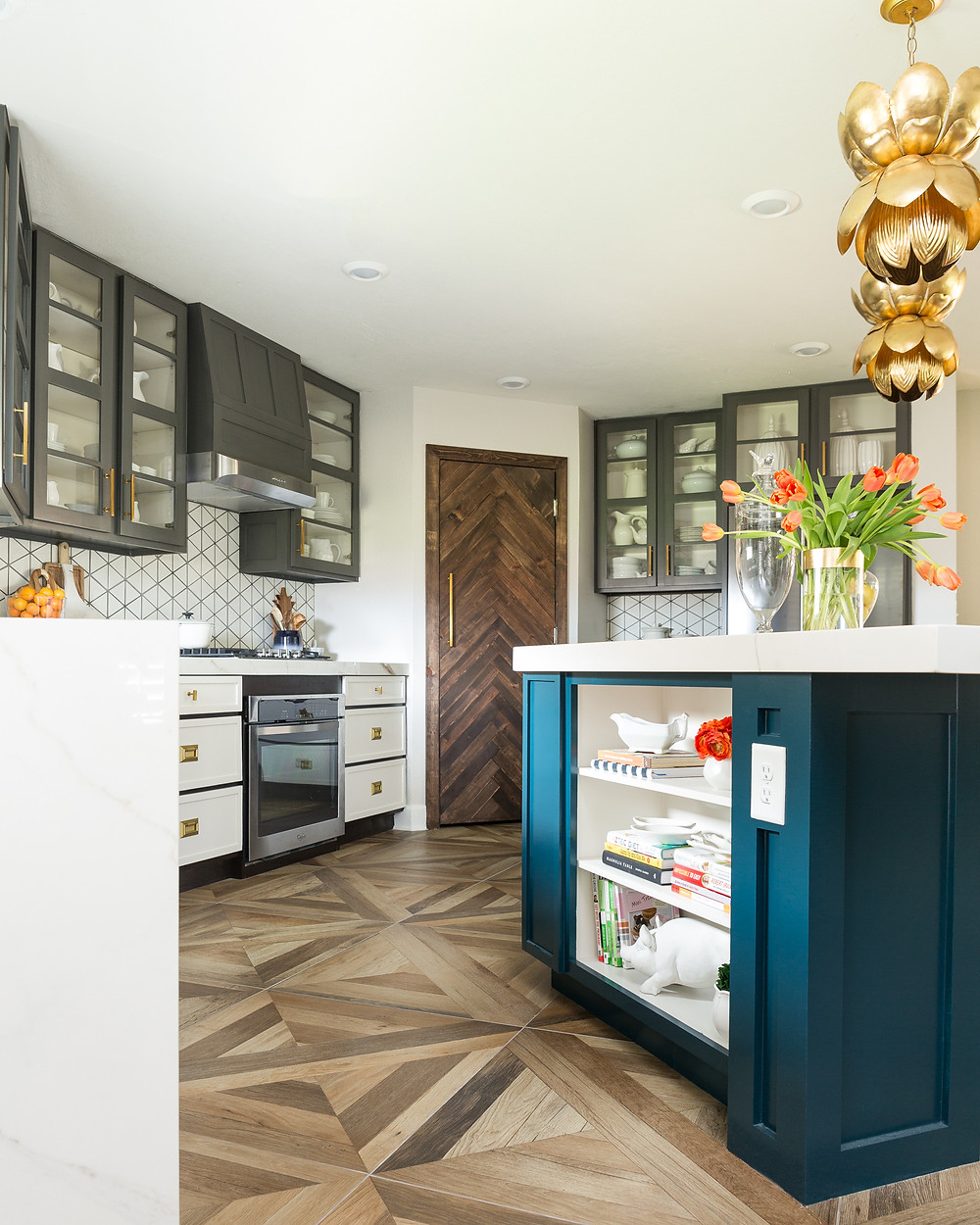 Kitchen design with blue island and gray and white cabinets