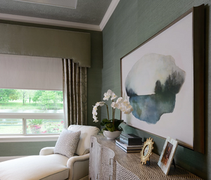 A traditional bedroom with chaise lounge overlooking the Brazos River