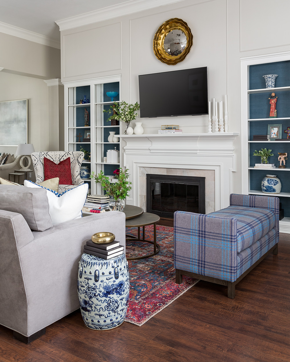 Traditional Color Palette Of Red, Blue And Cream, Grasscloth In Bookcase, Television Above Mantel