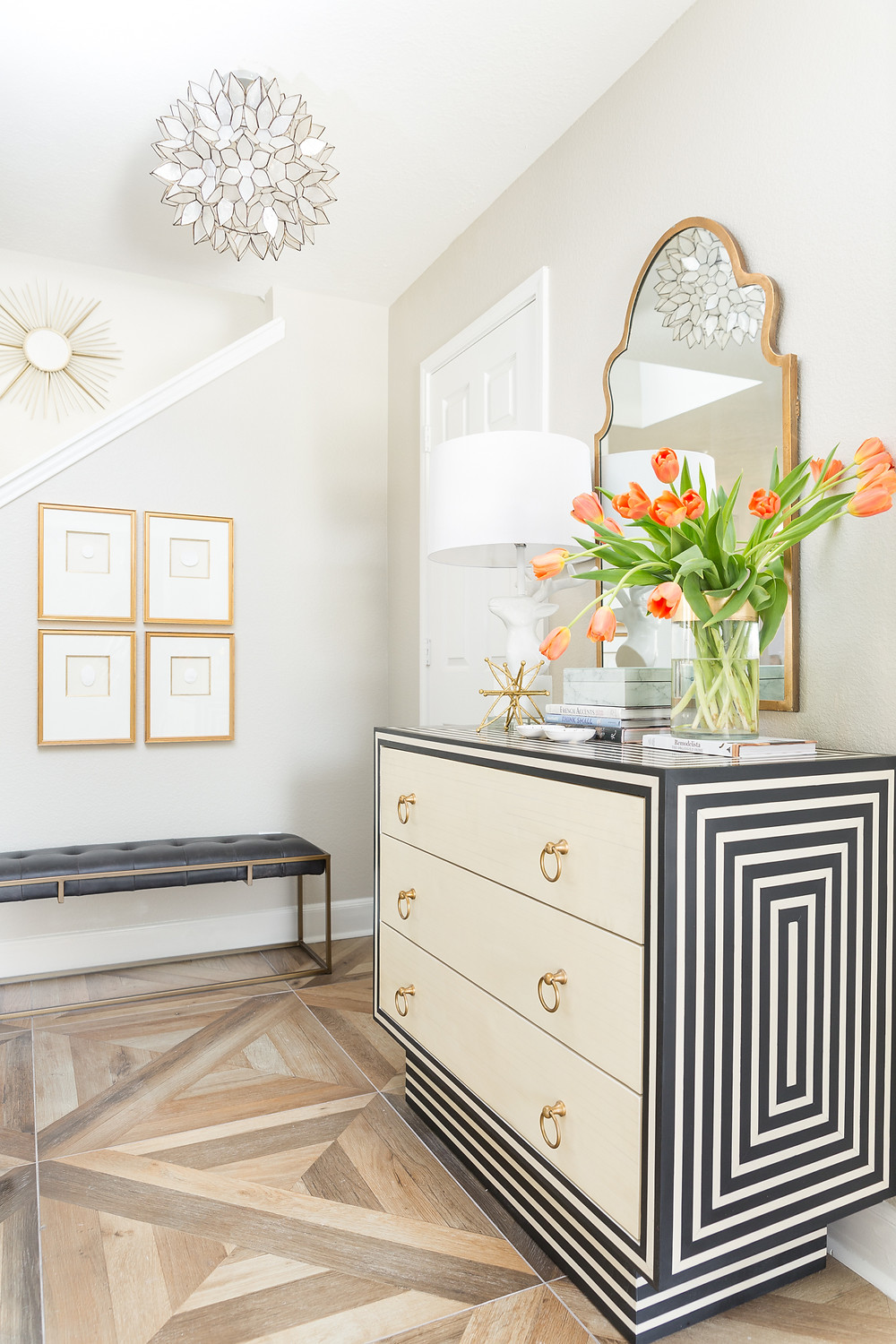 Foyer with black and cream striped chest
