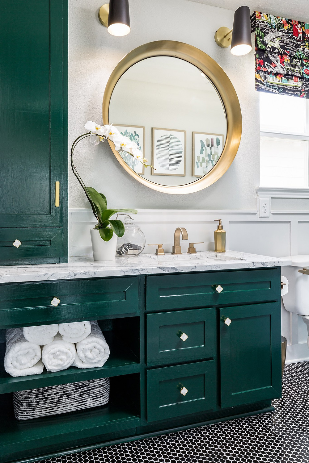 Guest bathroom with green cabinetry and marble countertops