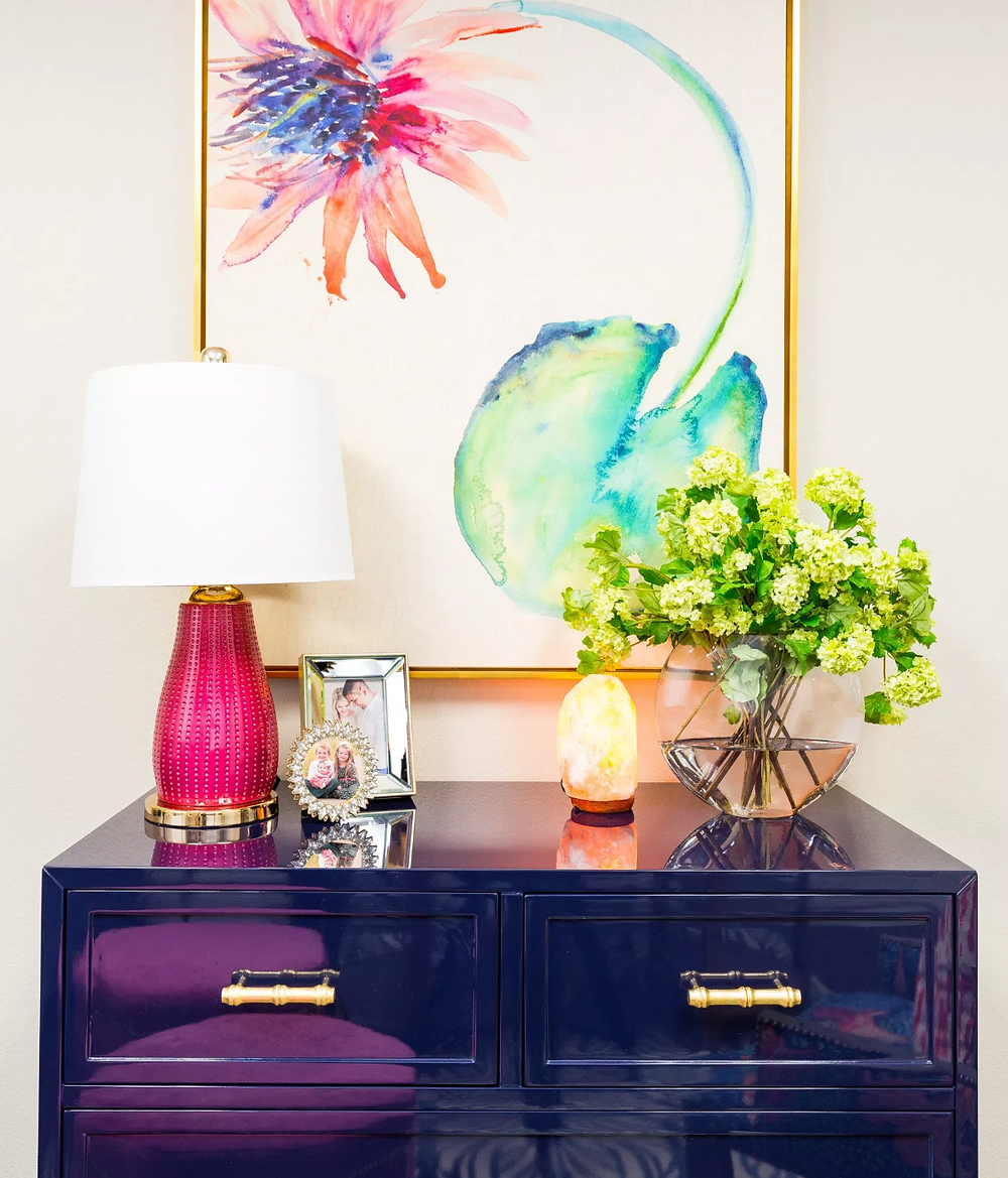 Colorful office space with navy lacquer chest
