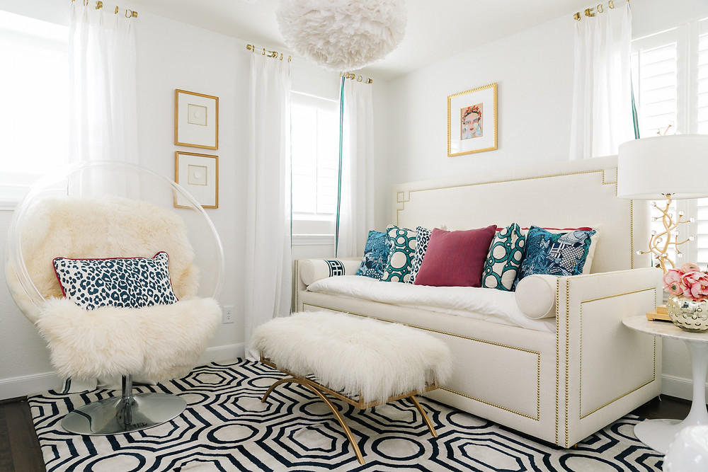 White Bedroom with daybed and pops of bold colors