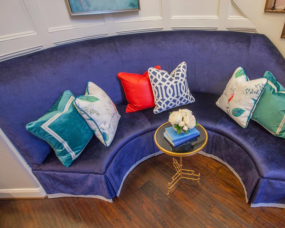 Foyer with built in velvet blue bench